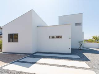Дома в стиле модерн от 株式会社 T.N.A Модерн