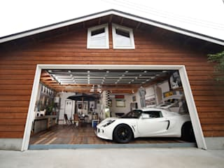 Country style garage/shed by J-STYLE GARAGE Co.,Ltd. Country