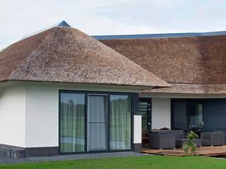 Casas de estilo  por Building Design Architectuur
