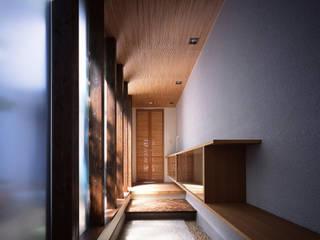 新宮苑の家 House In shinguen: 飯塚建築工房が手掛けた廊下 & 玄関です。
