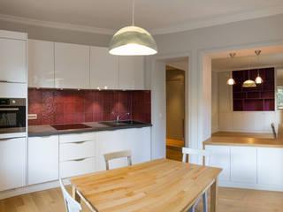 Rue D'arcole: Salle à manger de style de style Moderne par Agence sébastien Markoc