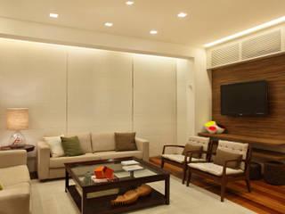 Casa 21: Salas de estar  por Estúdio Barino | Interiores,Moderno