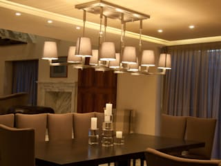 Dining room by Iluminarq, Modern