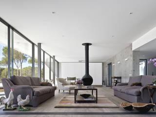 Casa na Comporta: Salas de estar  por RRJ Arquitectos