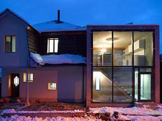 Erweiterung und Umnutzung Wohnhaus von sim Architekten GmbH