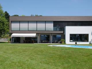 Villas de estilo  de Hunkeler Partner Architekten AG, Moderno