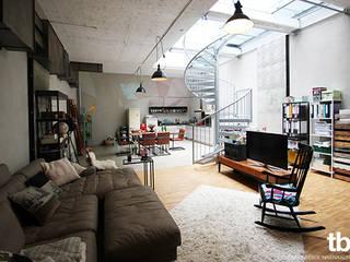 Salas de estar industriais por tbia - Thomas Bieber InnenArchitekten