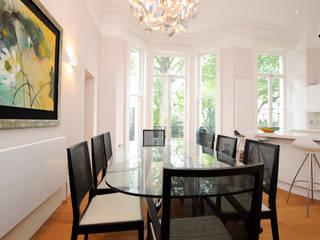 Dining room by NSI DESIGN LTD, Modern