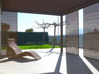 VIVIENDA MARTINEZ-REQUENA Jardines de estilo minimalista de Q+C Arquitectura y Ciudad Minimalista