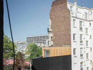 facade arrière: Maisons de style de style Moderne par bump architectes
