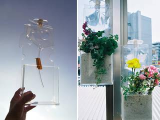 点滴パックを給水に利用したプランター: 遠藤浩建築設計事務所 H,ENDOH  ARCHTECT  &  ASSOCIATESが手掛けた現代のです。,モダン
