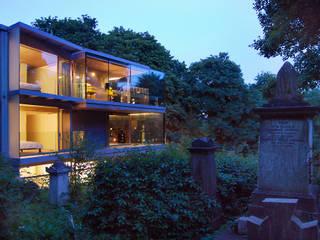 Night view from cemetery Minimalist houses by Eldridge London Minimalist Glass