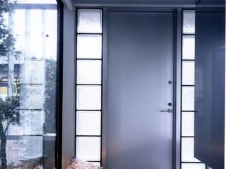 アンダンテの家: 加藤將己/株・将建築設計事務所が手掛けた壁です。