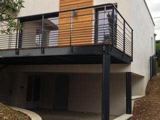 Extension sur existant: Maisons de style  par Steiner architecture intérieure