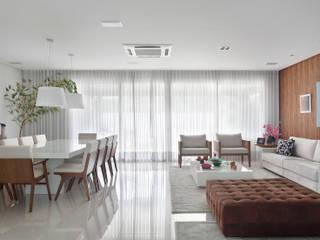 Livings de estilo moderno de Carolina Mendonça Projetos de Arquitetura e Interiores LTDA Moderno