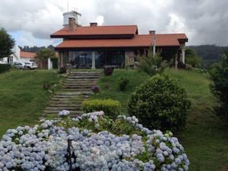 Vista exterior de la vivienda. Alzado sur.: Casas de estilo  de DE DIEGO ZUAZO ARQUITECTOS