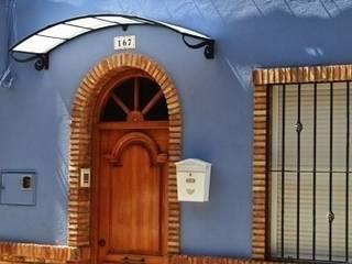 Cubierta con forma: Casas de estilo  de Deferro