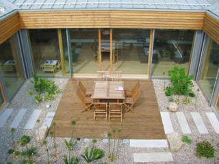 Terrazas de estilo  de Moserarchitekten