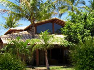 Houses by Cria Arquitetura, Tropical
