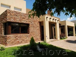 Casas de estilo  de Opra Nova - Arquitectos - Buenos Aires - Zona Oeste