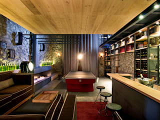 eclectic Wine cellar by Weber Arquitectos