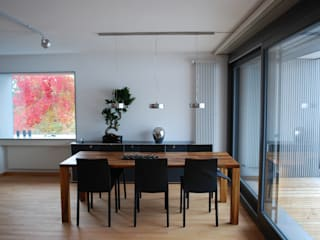 Modern dining room by AESCHLIMANN ARCHITEKTEN Modern