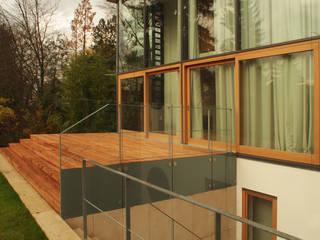 Ansicht Süd-West mit Atrium:  Häuser von Kramm + Strigl  Architekten und Stadtplaner