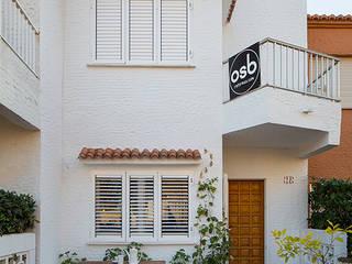 Mediterranean style houses by osb arquitectos Mediterranean