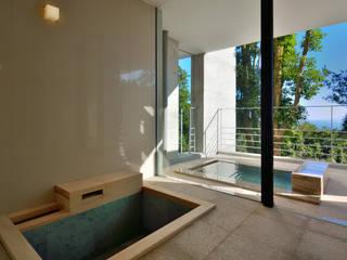 霧島の別荘: アトリエ環 建築設計事務所が手掛けた浴室です。