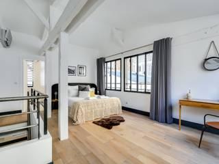 Camera da letto in stile in stile Industriale di Meero
