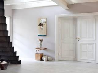 Pasillos, vestíbulos y escaleras modernos de raphaeldesign Moderno