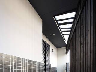 有限会社タクト設計事務所 Casas de estilo asiático