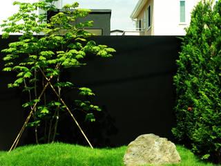 Сад в стиле модерн от 山越健造デザインスタジオ Kenzo Yamakoshi Design Studio Модерн