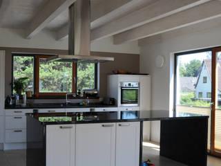 Modern kitchen by Dammann-Haus GmbH Modern