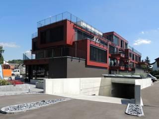 Wohn- Geschäftshaus, Bassersdorf: moderne Häuser von WAP Wagner Architekten + Partner AG