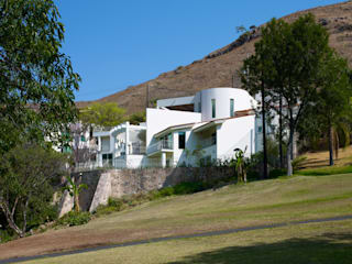 Casas de estilo  por Excelencia en Diseño,