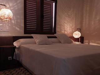 Dormitorios de estilo mediterráneo de DyD Interiorismo - Chelo Alcañíz Mediterráneo