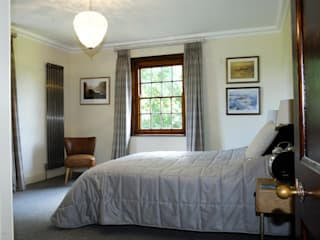 Raw metal vertical column radiator:  Bedroom by Mr Central Heating