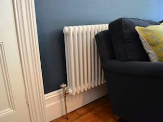 Three column white radiator:  Living room by Mr Central Heating