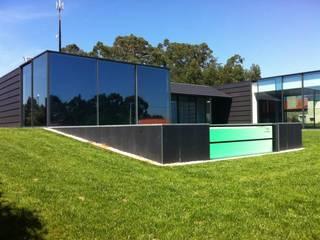 Casas estilo moderno: ideas, arquitectura e imágenes de Alberto Craveiro, Arquitecto Moderno