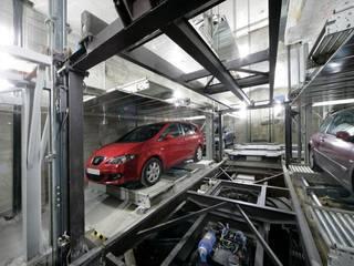 Bárbara de Braganza 8, Madrid. Rehabilitación de edificio para 9 viviendas y garaje robotizado Garajes de estilo industrial de AURIANOVA ARQUITECTOS Industrial