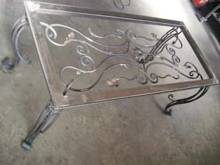 Finalizada la fabricación de la mesa Cervantes enrejado:  de estilo  de Forja Arroyo
