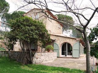 Houses by ARCHITETTO MARIANTONIETTA CANEPA