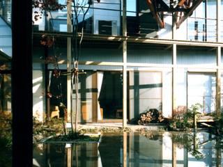有限会社加々美明建築設計室 Casas de estilo ecléctico Madera Blanco