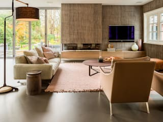 Salas de estar  por Design Gietvloer