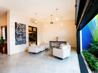 Salones de estilo  de Taller Estilo Arquitectura, Moderno