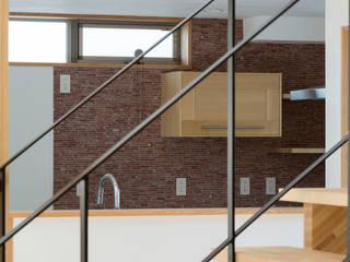 大岡山の家: (有)伊藤道代建築設計事務所が手掛けた廊下 & 玄関です。