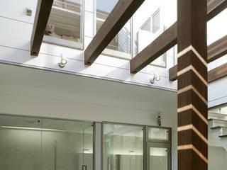 クアドリハウス: ツジデザイン一級建築士事務所が手掛けた庭です。
