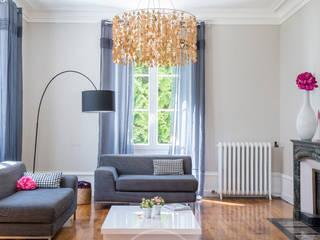 Livings de estilo ecléctico por Sandrine RIVIERE Photographie