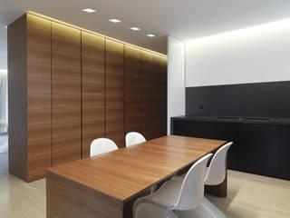 Residenza Privata Studio minimalista di Reggiani SPA Illuminazione Minimalista